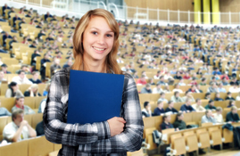 MD college student with her books at a larger lecture room